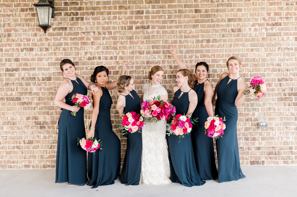 bride holding pink bouquet with navy bridesmaids at dove ridge vineyard, dallas wedding photographer