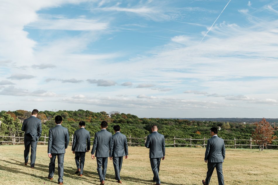 groomsmen walking at dove ridge vineyard, dallas wedding photographer