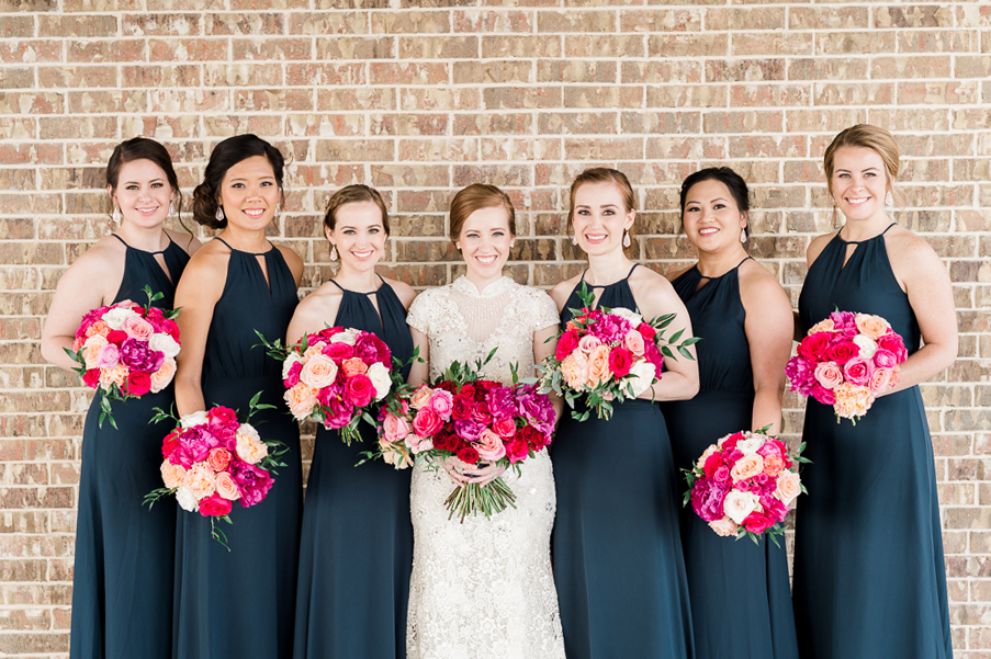 bride in the middle of bridesmaids navy, dresses, pink flowers, dallas wedding photographer, dove ridge vineyard