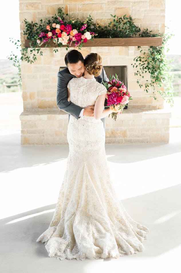 Bride and groom first look, dallas wedding photographer, hug, dove ridge vineyard